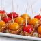 Cherries caramelizados bañados en sésamo